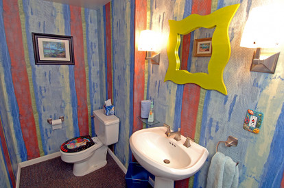 After removing a big brown vanity, the Caribbean theme was brought into the half bath.