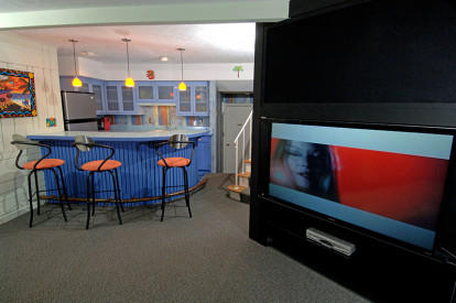 The formerly dark brown space was brightened, and a wide-screen TV was built in for football Sundays.